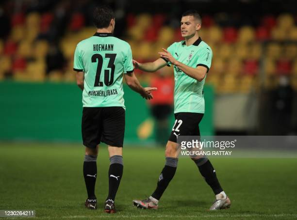 Moenchengladbach's Slovakian midfielder Laszlo Benes celebrates scoring with Moenchengladbach's German midfielder Jonas Hofmann during the German Cup...