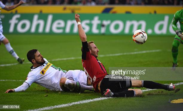 Moenchengladbach's Spanish defender Alvaro Dominguez and Ingolstadt's forward Moritz Hartmann vie for the ball during the German first division...