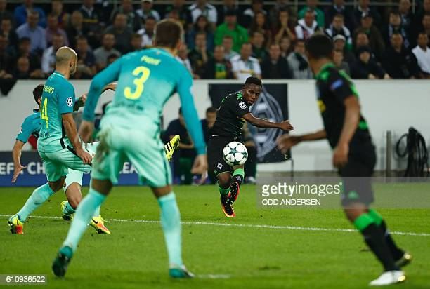 Moenchengladbach's Spanish defender Alvaro Dominguez shoots the ball during the UEFA Champions League firstleg group C football match between...