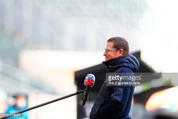 Moenchengladbach's sporting director Max Eberl smiles as he gives an interview ahead of the German first division Bundesliga football match Borussia...