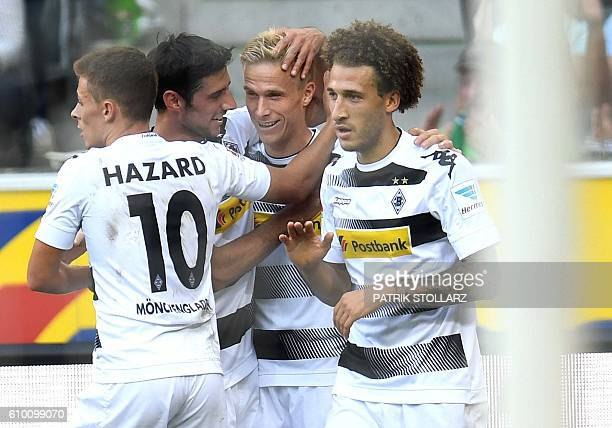 Moenchengladbach's Swedish defender Oscar Wendt and his teammates celebrate during the German first division Bundesliga football match between...