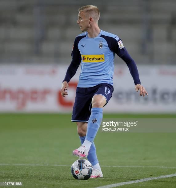 Moenchengladbach's Swedish defender Oscar Wendt controls the ball during the German first division Bundesliga football match SC Freiburg v Borussia...