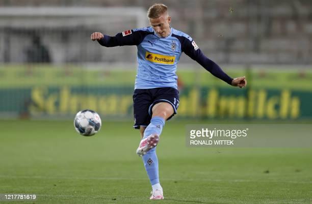 Moenchengladbach's Swedish defender Oscar Wendt plays the ball during the German first division Bundesliga football match SC Freiburg v Borussia...