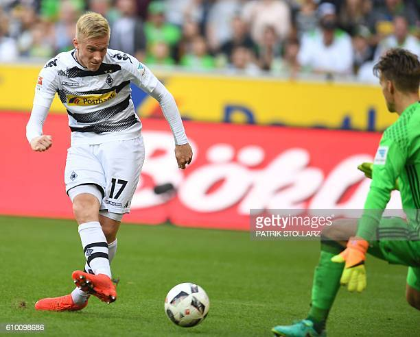 Moenchengladbach's Swedish defender Oscar Wendt scores against Ingolstadt´s Norwegian goalkeeper Oerjan Nyland during the German first division...