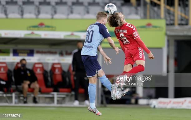 Moenchengladbach's Swiss defender Nico Elvedi and Freiburg's German forward Lucas Hoeler vie for the ball during the German first division Bundesliga...