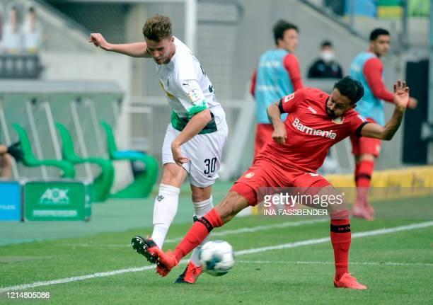 Moenchengladbach's Swiss defender Nico Elvedi and Leverkusen's German midfielder Karim Bellarabi vie for the ball during the German first division...