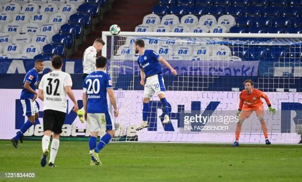 Moenchengladbach's Swiss defender Nico Elvedi heads the ball during the German first division Bundesliga football match between FC Schalke 04 and...