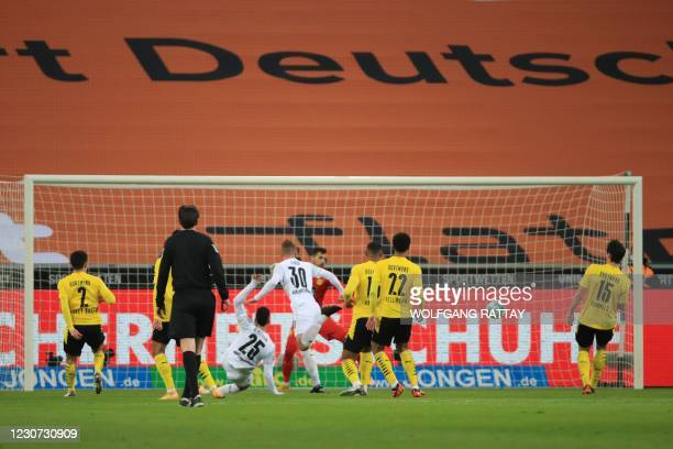 Moenchengladbach's Swiss defender Nico Elvedi heads the ball to score the opening goal during the German first division Bundesliga football match...