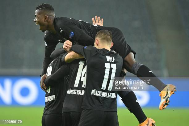 Moenchengladbach's Swiss forward Breel Embolo and his teammates celebrate a goal which was then called offside during the UEFA Champions League...