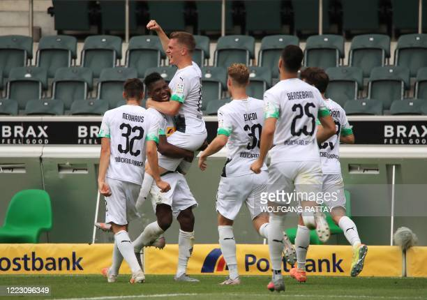Moenchengladbach's Swiss forward Breel Embolo celebrates scoring his team's second goal during the German first division Bundesliga football match...