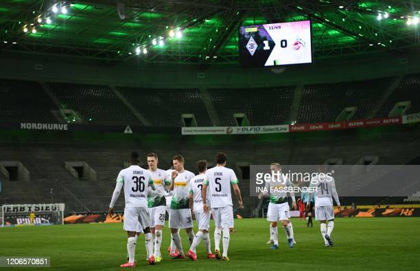 Moenchengladbach's Swiss forward Breel Embolo celebrates scoring the opening goal with his teammates during the German first division Bundesliga...