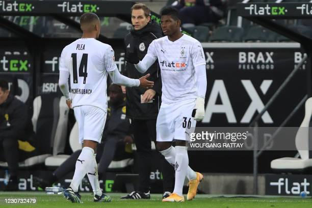 Moenchengladbach's Swiss forward Breel Embolo comes on the pitch for Moenchengladbach's French forward Alassane Plea during the German first division...