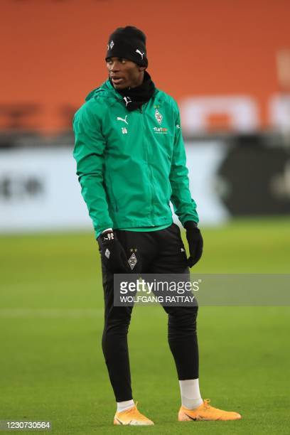 Moenchengladbach's Swiss forward Breel Embolo stands on the field prior to the German first division Bundesliga football match Borussia...