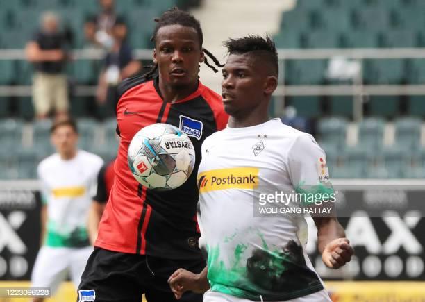 Moenchengladbach's Swiss forward Breel Embolo vies with Hertha Berlin's Belgian defender Dedryck Boyata during the German first division Bundesliga...