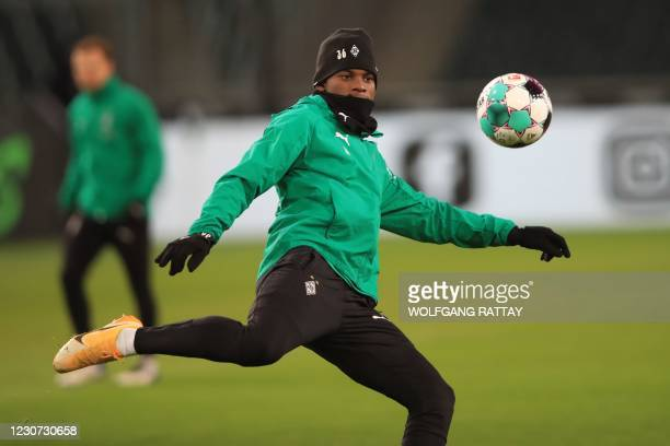 Moenchengladbach's Swiss forward Breel Embolo warms up prior to the German first division Bundesliga football match Borussia Moenchengladbach v BVB...