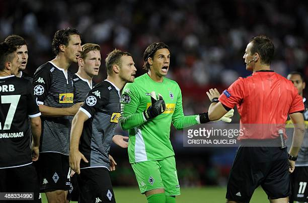 Moenchengladbach's Swiss goalkeeper Yann Sommer complains to the referee Pavel Kralovec during the UEFA Champions League group D football match...