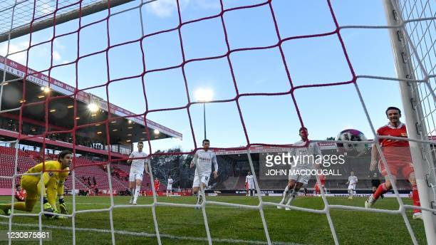 Moenchengladbach's Swiss goalkeeper Yann Sommer fails to keep out the first goal during the German first division Bundesliga football match between 1...