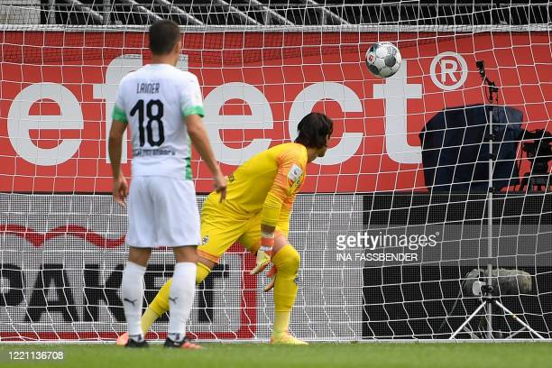 Moenchengladbach's Swiss goalkeeper Yann Sommer fails to save the ball during the German first division Bundesliga football match SC Paderborn v...