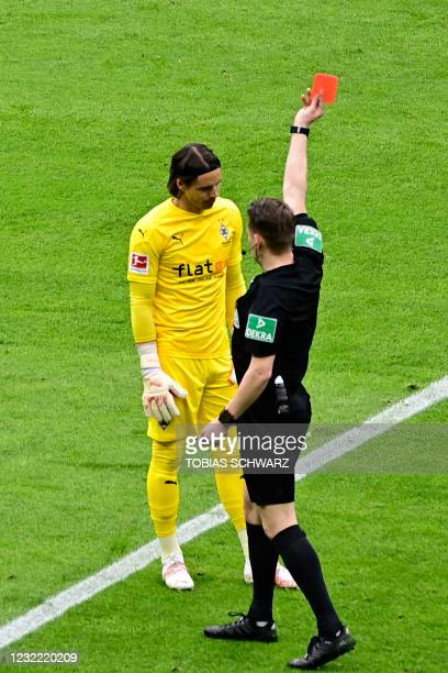 Moenchengladbach's Swiss goalkeeper Yann Sommer is shown a red card during the German first division Bundesliga football match between Hertha BSC...