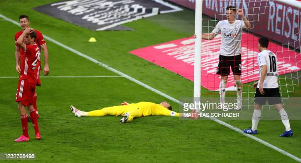 Moenchengladbach's Swiss goalkeeper Yann Sommer lays on the pitch during the German first division Bundesliga football match FC Bayern Munich v...