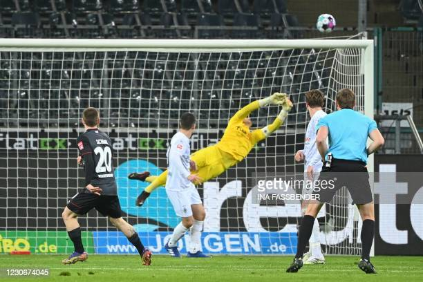Moenchengladbach's Swiss goalkeeper Yann Sommer saves the shot by Bremen's Austrian midfielder Romano Schmid during the German first division...