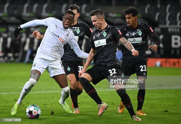Moenchengladbach's Swiss midfielder Denis Zakaria and Bremen's Austrian forward Marco Friedl vie for the ball during the German first division...