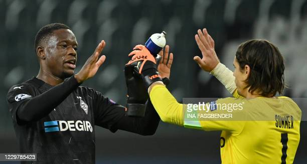 Moenchengladbach's Swiss midfielder Denis Zakaria and Moenchengladbach's Swiss goalkeeper Yann Sommer react after the UEFA Champions League group B...