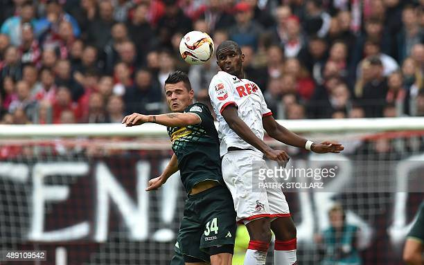 Moenchengladbach's Swiss midfielder Granit Xhaka and Cologne's French forward Anthony Modeste vie for the ball during the German first division...