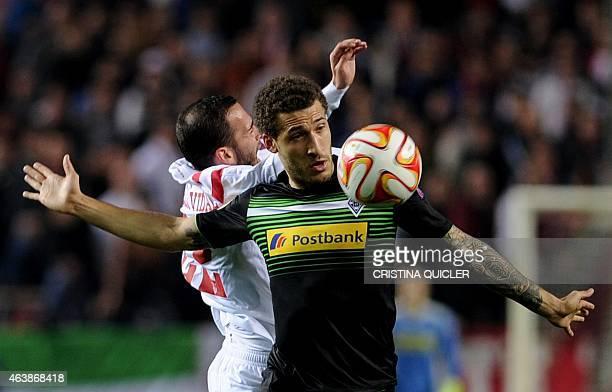 Moenchengladbach's US defender Fabian Johnson vies with Sevilla's midfielder Aleix Vidal during the UEFA Europa League football match Sevilla FC vs...