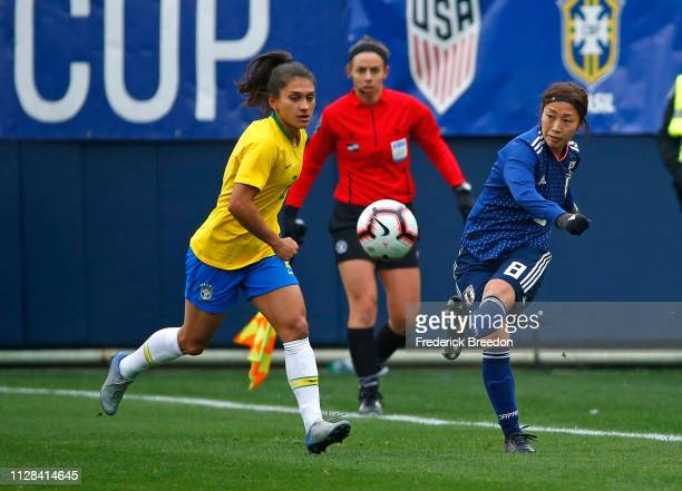 Moeno Sakaguchi of Japan kicks a ball past Leticia S #2 of Brazil during the first half of the 2019 SheBelieves Cup match between Brazil and Japan...
