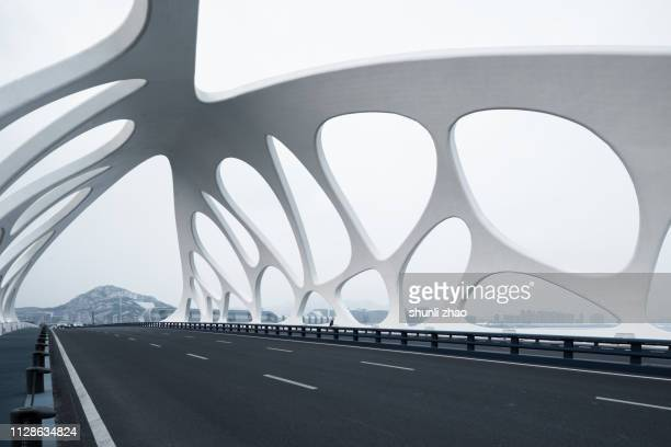 moern bridge with strange structures, qingdao - man made structure stock pictures, royalty-free photos & images