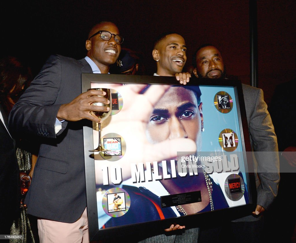 Moet brand manager Keith Howard (L) and recording artist Big Sean attend Moet Rose Lounge Los Angeles hosted by Big Sean at The London West Hollywood on August 13, 2013 in West Hollywood, California.