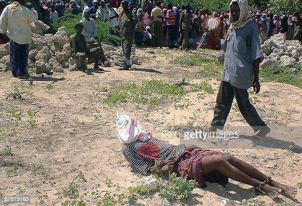 A photo from the Shabelle Media group in Somalia shows a Somali teenager killing 02 May 2006 a man convicted by an Islamic court of murdering his...