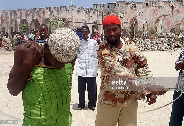 File picture of Mohamed Shegow a 19yearold drug user from Mogadishu receiving 17 slashes from a Muslim cleric 19 August 2006 in an open ground in...
