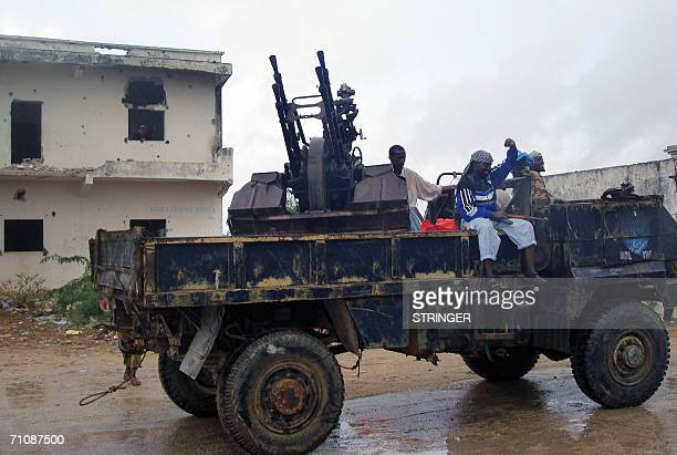 Islamic fighters on a heavy truck mounted with an antiaircraft gun patrol outside the main building at EX Bal'ad Control in Mogadishu Somalia 31 May...