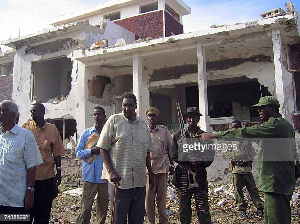 Mogadishu Mayor Mohamed Dheere checks the house of Somali Prime Minister Ali Mohamed Gedi 04 June 2007 following a deadly car bomb attack on his...