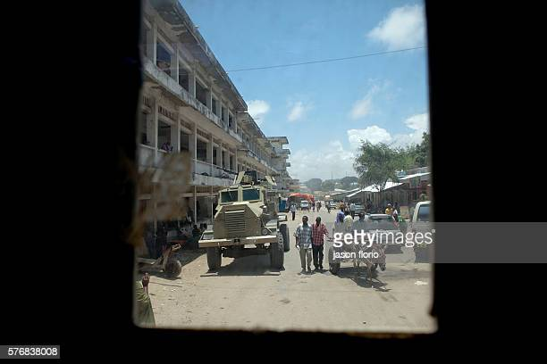 Mogadishu street scenes seen through the bullet proof glass of a Casspir armored vehicle