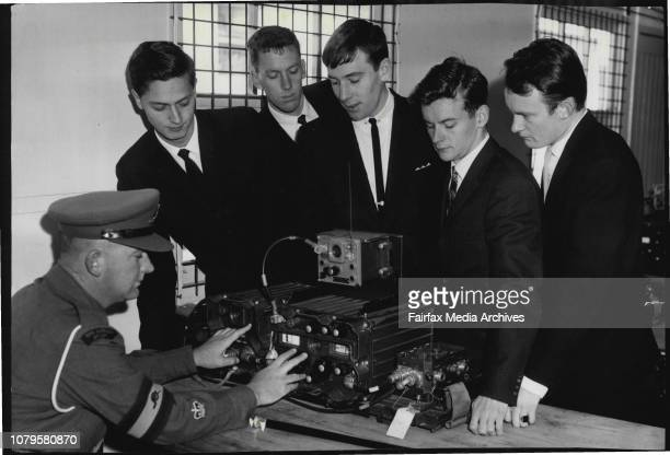 WO J Moggach showing a wireless set C 45 to Blair Weaver of Rockhampton Roger Brown of St Peter's Sydney Glenn Williams of Ballarat David KampR...