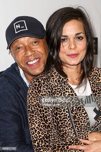 Mogul Russell Simmons and director Lina Esco arrive at the Free The Nipple fundraiser at SkyBar at the Mondrian Los Angeles on June 19 2014 in West...