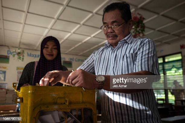 Mohagher Iqbal Chief Peace Negotiator of the Moro Islamic Liberation Front cast his vote in his hometown on January 21 2019 in Bugawas Maguindanao...