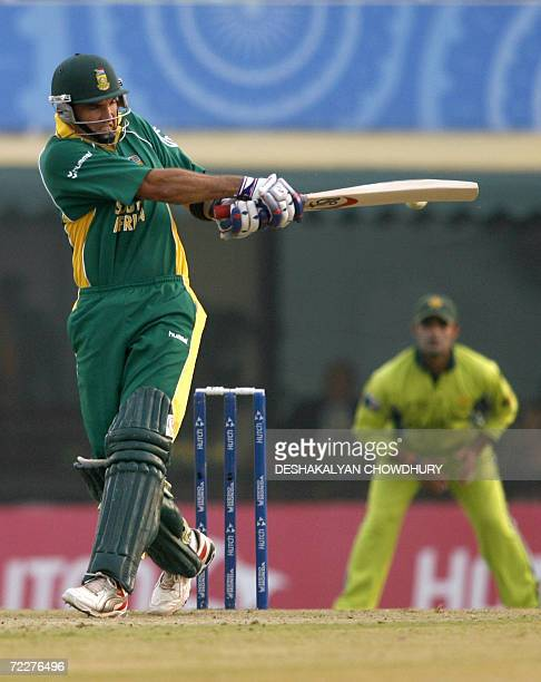 South African batsman Justin Kemp plays a shot during a ICC Champions Trophy 2006 tournament match at The Punjab Cricket Association Stadium in...
