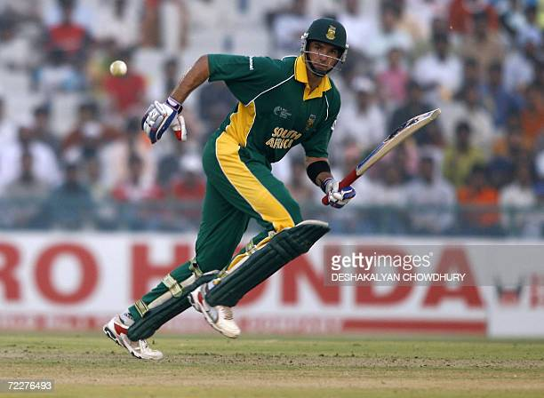 South African batsman Justin Kemp takes a short run during a ICC Champions Trophy 2006 tournament match at The Punjab Cricket Association Stadium in...