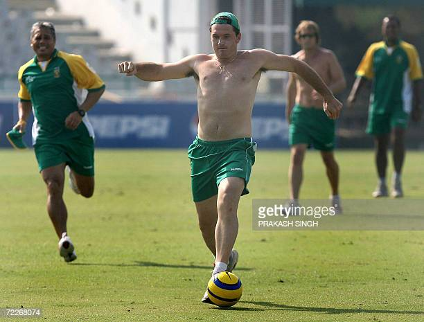 South African cricket captain Graeme Smith controls a football during a training session at The Punjab Cricket Association Stadium in Mohali 26...