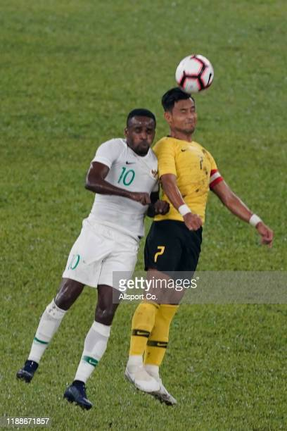 Mohamad Aidil Zafuan of Malaysia battles Greg Nwokolo of Indonesia during the 2022 Qatar FIFA World Cup Asian qualifier group G match between...