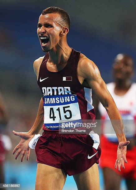 Mohamad Al Garni of Qatar celebrates after claiming the Gold medal following the Mens's 5,000m Final during day eight of the 2014 Asian Games at...