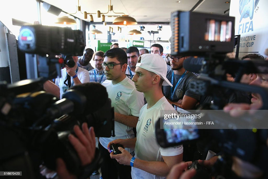 Mohamad Al-Bacha of Demark plays with Johan Simon (R) of France during the quarter finale for the FIFA Interactive World Cup 2016 at The Skylark lounge New York downtown Manhattan on March 21, 2016 in New York City.