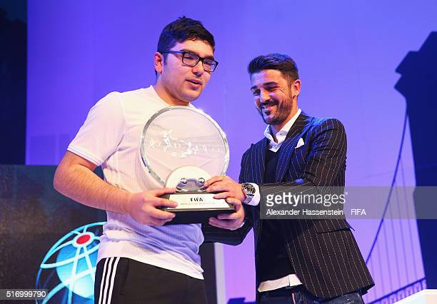 Mohamad AlBacha of Denmark celebrates with the trophy presented by David Villa of New York City FC after defeating Sean Allen of England during the...