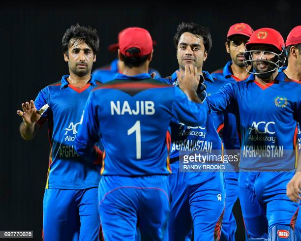 Mohamad Asghar Stanikzai Rashid Khan and Shafiqullah Shafaq congratulate Najibullah Zadran of Afghanistan for taking the catch to dismiss Lendl...