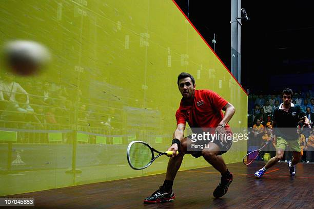 Mohamad Azlan Iskandar of Malaysia competes in the Men's Individual Final squash match against Khan Aamir Atlas of Pakistan at Asian Games Town...