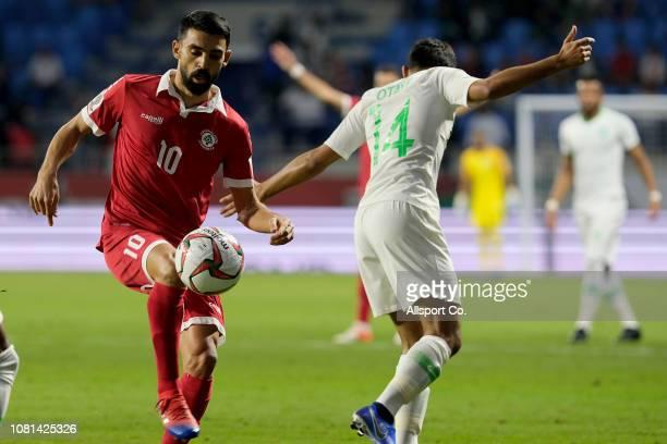 Mohamad Haidar of Lebanon holds off Abdullah Otayf of Saudi Arabia during the AFC Asian Cup Group E match between Lebanon and Saudi Arabia at Al...